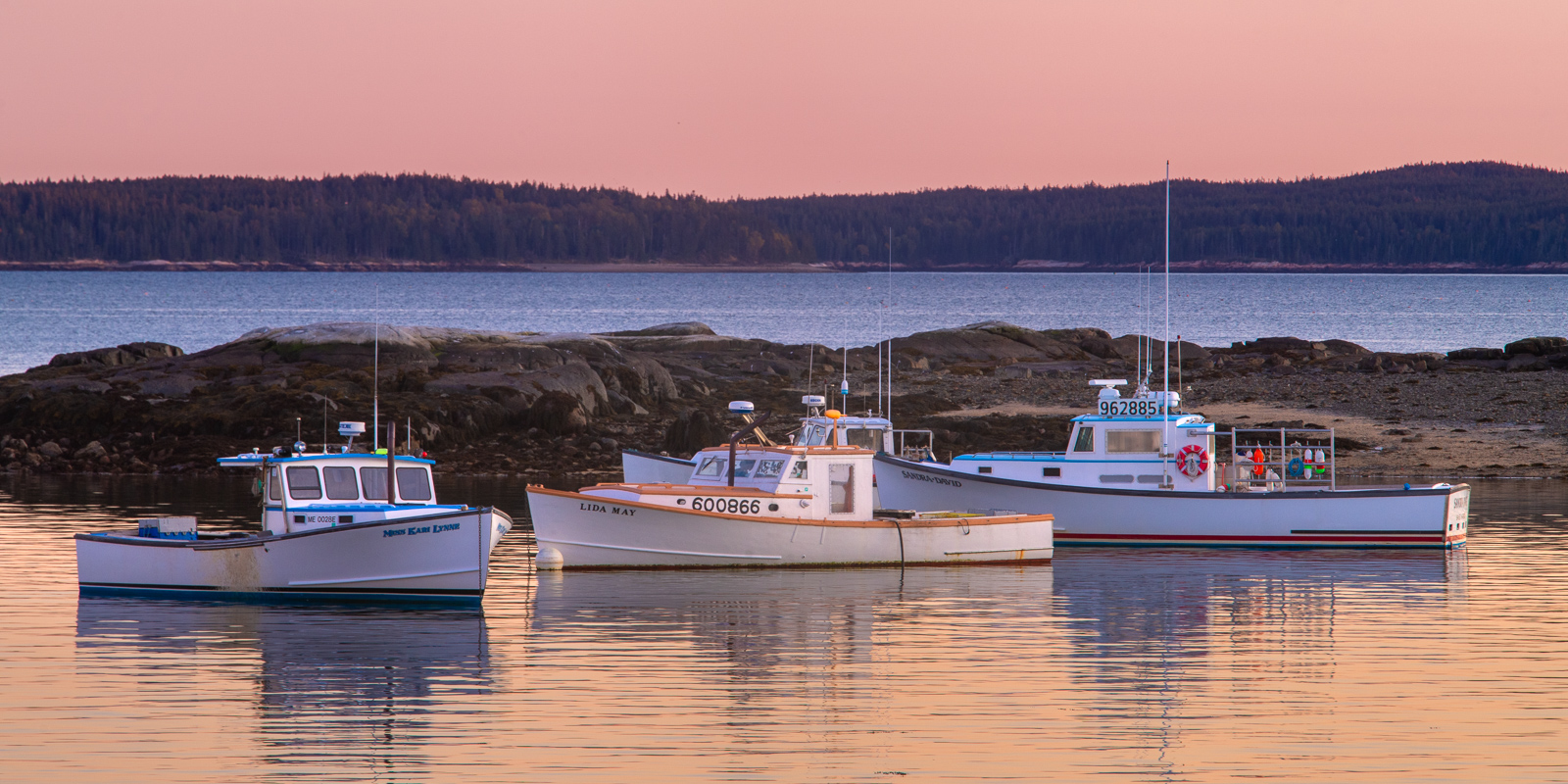 Three Lobster Boats at twilight in Bass Harbor, Maine.