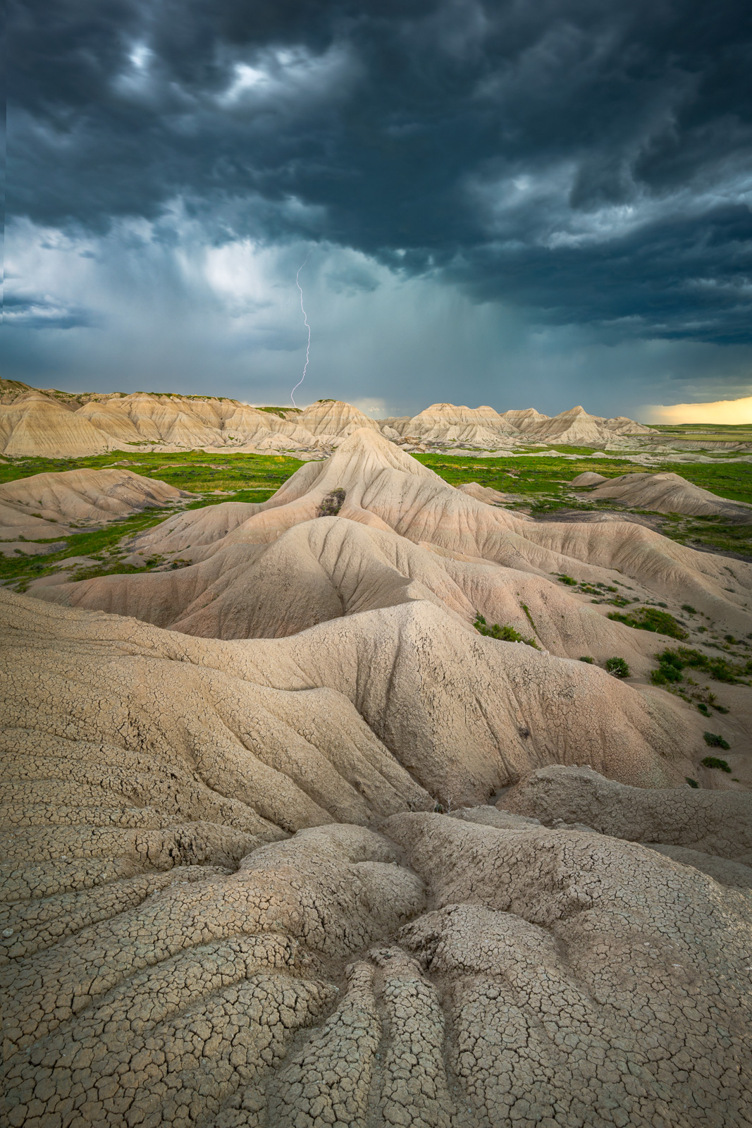Lightning and a massive super cell thunderstorm captured from tyhe remote badlands of Toadstool Geologic Preserve in western...