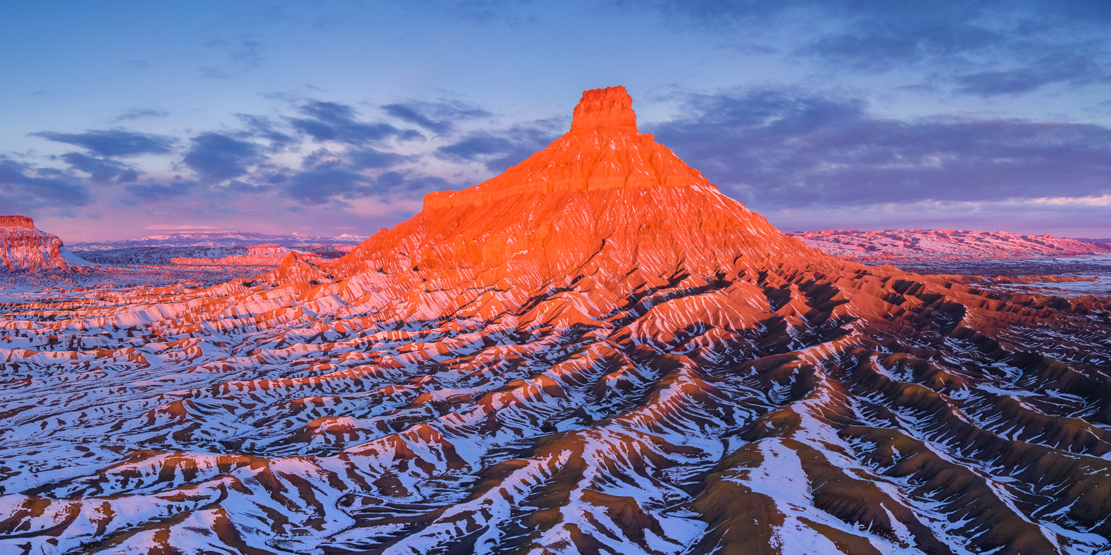 Factory Butte after a recent winter snowfall in the San Rafeal Swell of Southern Utah.